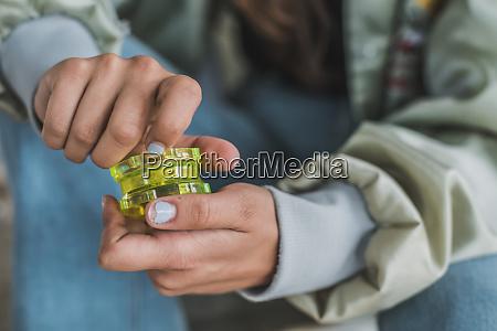 woman preparing marihuana joint close up