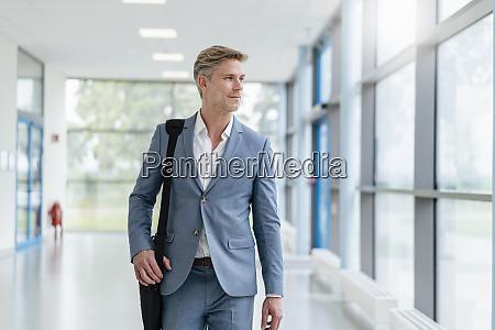 businessman walking in a passageway