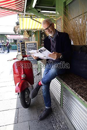 mature man waiting at the market