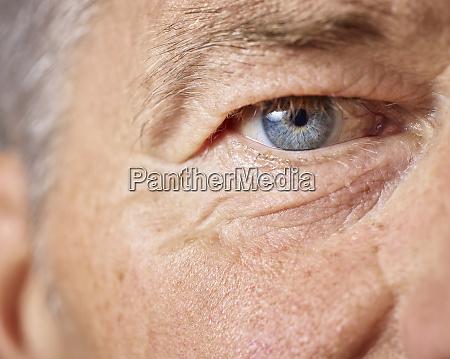blue eye of mature man