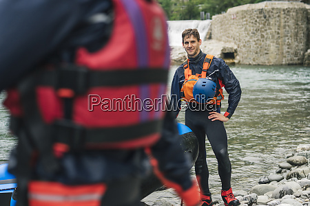 smiling man with rubber dinghy at