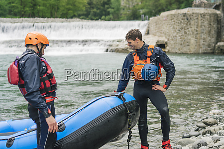 two men with rubber dinghy at