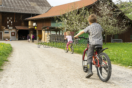 girl and boy riding bicycle at