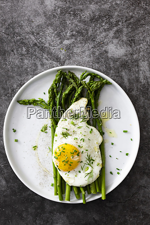 asparagus and fried egg on a