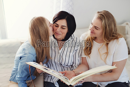 grown up daughters visiting their mother