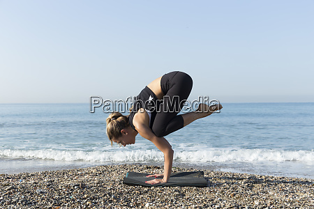 young woman practicing yoga on the