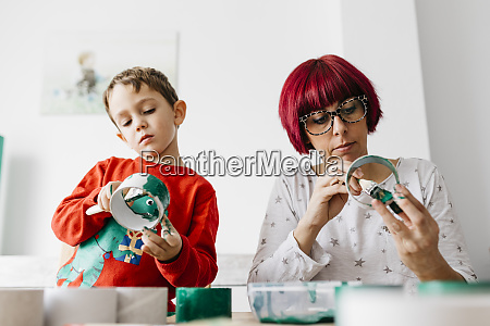 mother and son doing crafts at