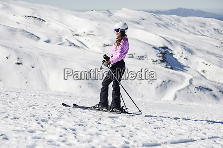 woman skiing on snow covered landscape