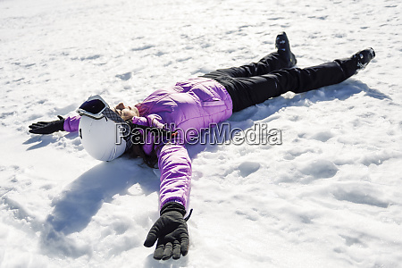 woman taking a break after skiing