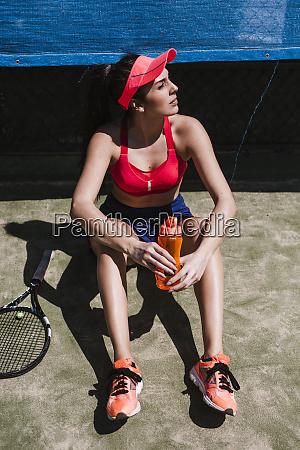 female tennis player sitting on court