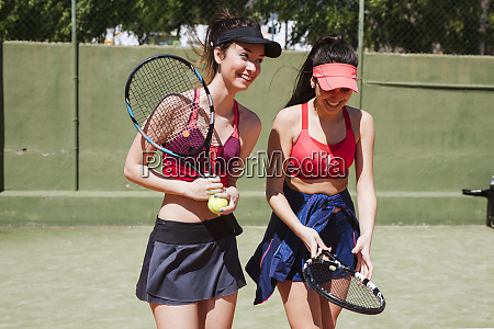 two happy female tennis players on