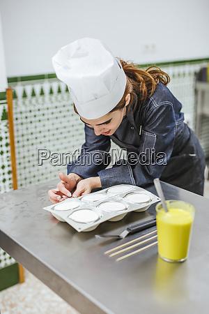 junior chef prepairing a dessert
