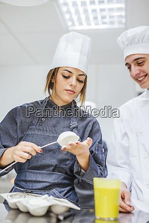 junior chefs prepairing a dessert
