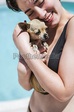 young women with chihuahua at the