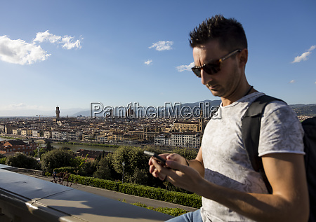 man using his smartphone florence italy