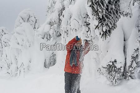 laughing boy having fun at winter