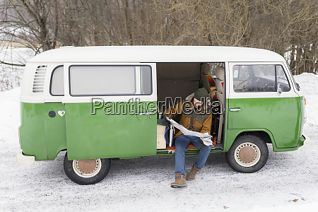 man with electric van in winter