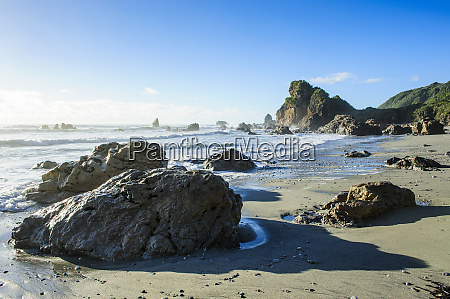 boulders on a beach on the