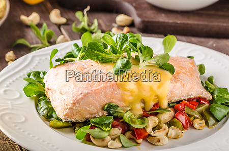 salmon with hollandaise sauce and salad