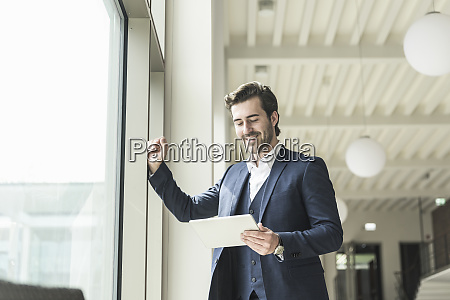 successful manager standing in modern office
