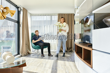 couple at home man listening music