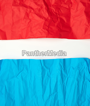 crumpled red and blue on paper