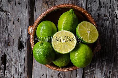 fresh lime on wood board bio