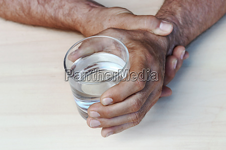 the hands of a man with
