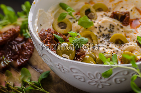 fresh cheese with olives dried tomatoes