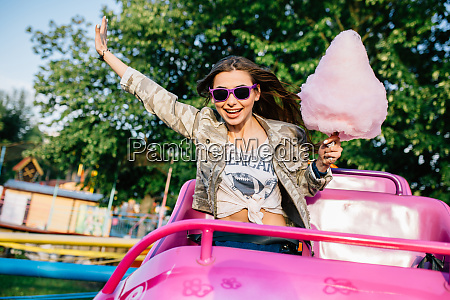 stylish girl riding a roller coaster