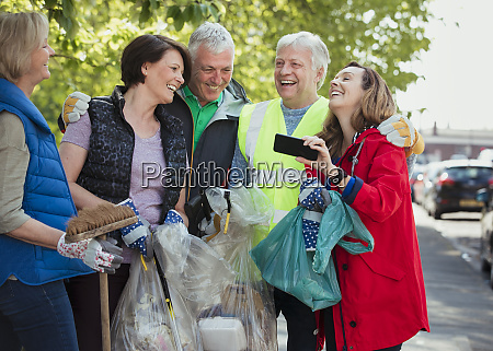 city cleaners laughing