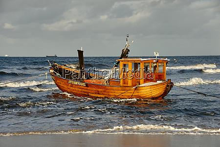 fisher boat on beach of isle