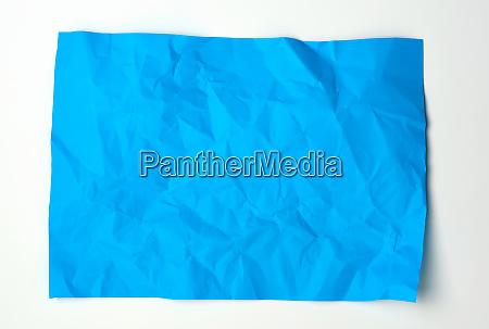 crumpled blue rectangular sheet of paper