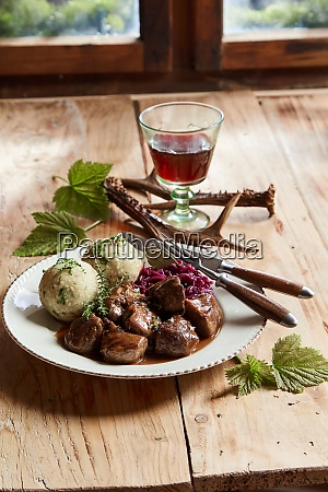 venison goulash with dumplings and fresh