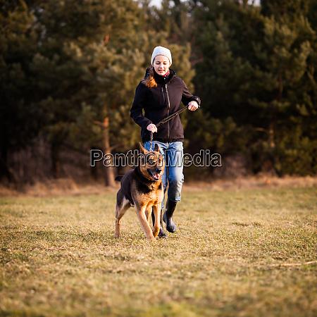 master and her obedient german shepherd