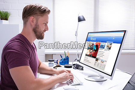 person reading news on computer