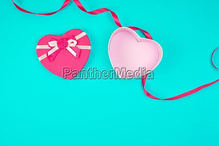 open pink heart shaped gift box