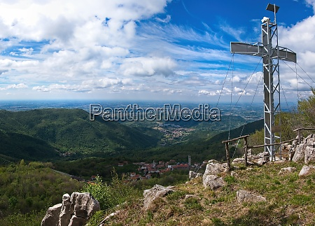mountain peak with cross and dramatic