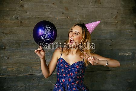 funny girl in birthday hat celebrating