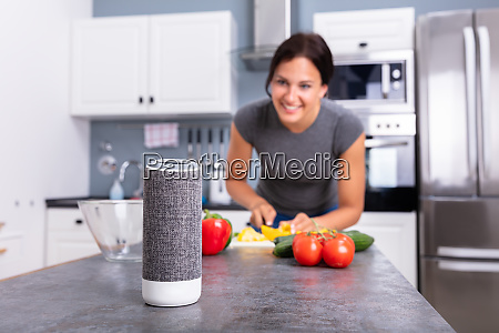 woman listening music on wireless speaker