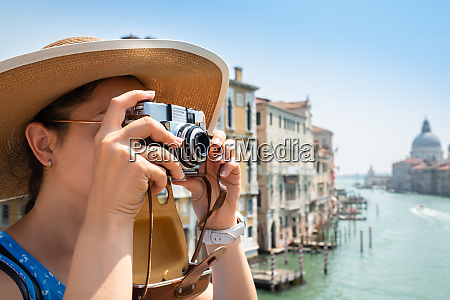 woman taking pictures on camera in