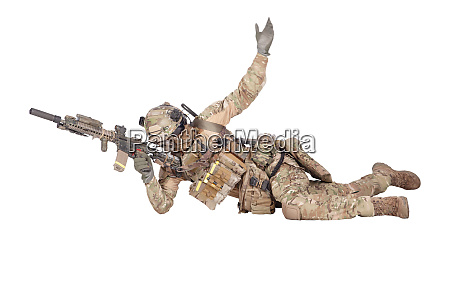 soldier shooting from ground isolated studio