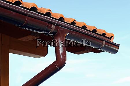 gutter on a wooden garage a