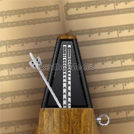 vintage swinging metronome on page of