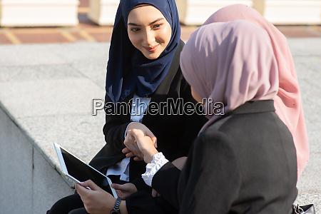muslim business women discussing and handshake