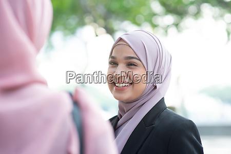 muslim business woman talking
