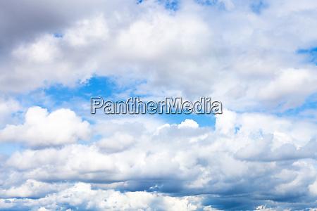 low dense cumulus clouds in blue