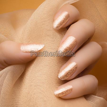 glittered beige nails
