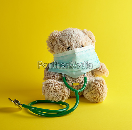 gray teddy bear and green medical