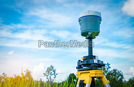gps surveying equipment on blue sky